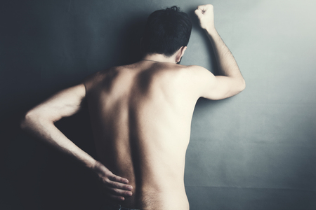 young man with back and neck pain 写真素材