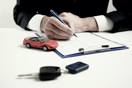 man hand car and document on table Banque d'images