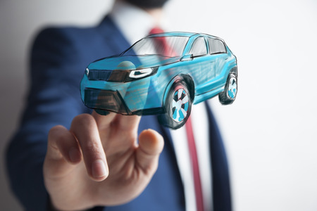businessman touching car in screen in background