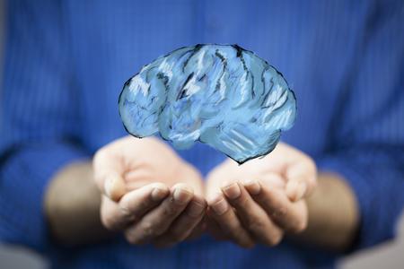 businessman holding digital image of brain in palm Stockfoto