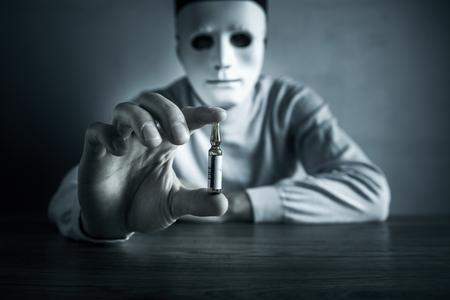 Man face mask and hand drug on desk