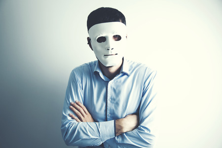 young man face white mask on gray background
