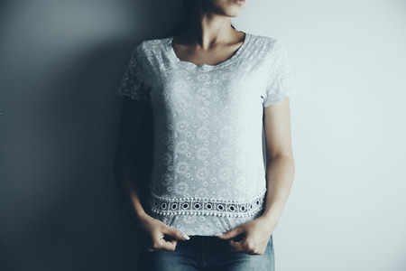 t-shirt on a woman in gray background