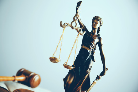 Statue of justice and Wooden gavel on desk