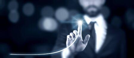 man  touching virtual screen on the dark background Stok Fotoğraf