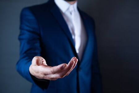 Businessman pressing button on virtual screen  on the dark background