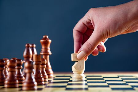 businesswoman playing a game of chess  on the dark background