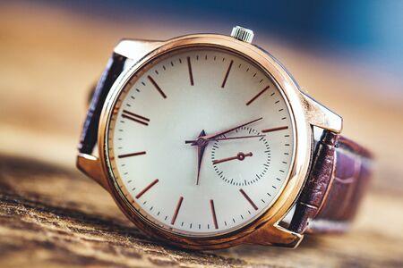 man elegant watch on wooden table background Stok Fotoğraf