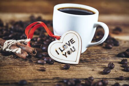 coffee cup with beans and heart on the desk