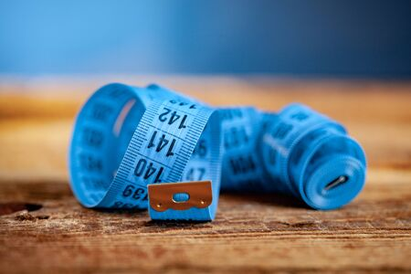 measuring tape on the wooden table background