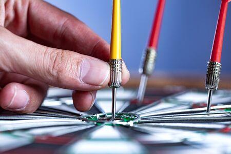 man hand arrow on center of dartboard