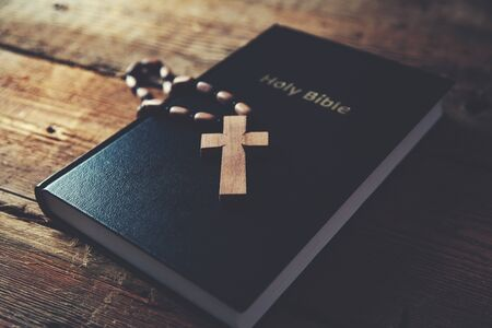 cross on holy bible on the wooden table