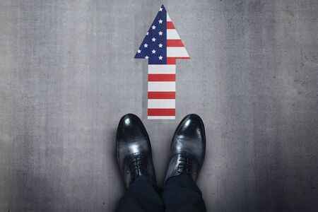 person feet with USA flag on asphalt Stock Photo