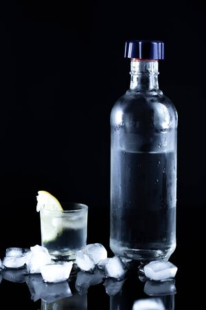 bottle of vodka with limon on the desk