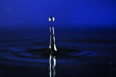 a drop of a water blue background Stok Fotoğraf