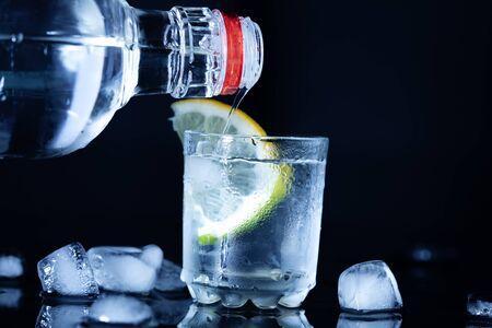 bottle of vodka with glass  on the desk Stok Fotoğraf