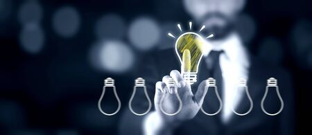 man touching in light bulb in screen Stock Photo - 129330775