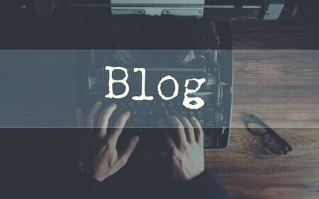 Typewriter with blog and man hand