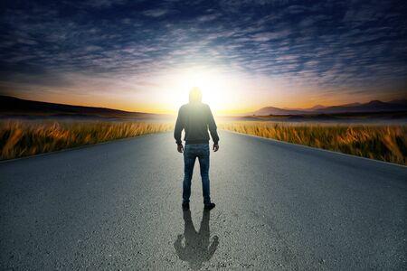man in  road at sunset Stock fotó