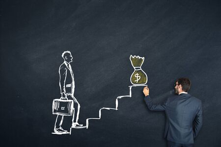 man drawing walking on a stairs on chalkboard Stock Photo