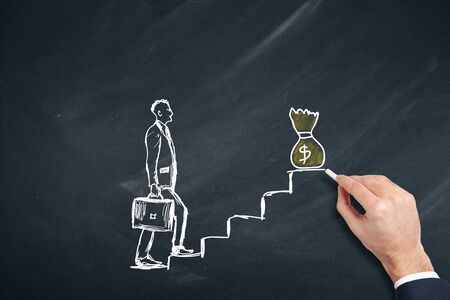 man drawing walking on a stairs for a trophy on chalkboard Stock Photo - 129331072