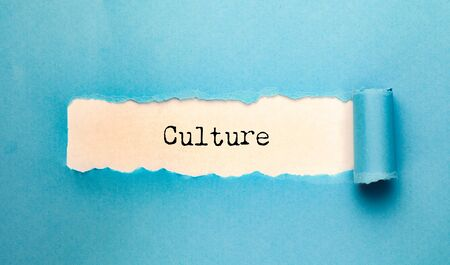 culture text with torn paper