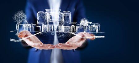 man touching house model in screen Stock fotó