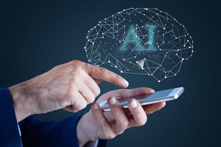 Man hand phone with AI text with brain Stock Photo
