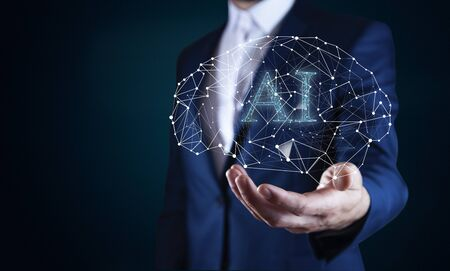 AI text with brain in man hand