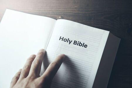 man hand Holy Bible text