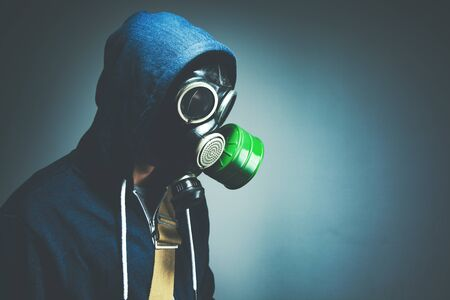 the man in a gas mask on dark background