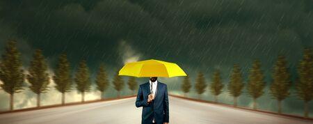 man hand yellow umbrella in rain