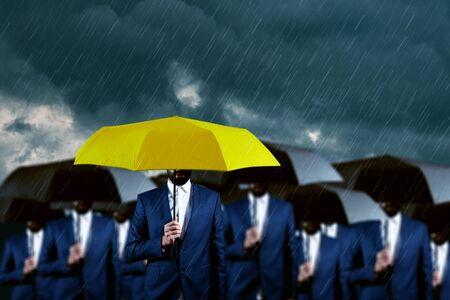 hand yellow and black umbrella under sky Stok Fotoğraf - 129831562
