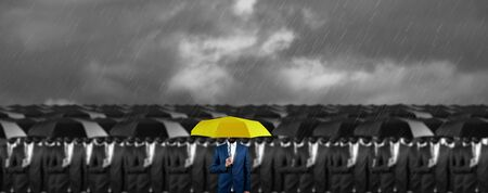 hand yellow and black umbrella under sky