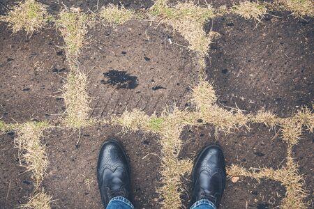 man black shoes on asphalt Imagens