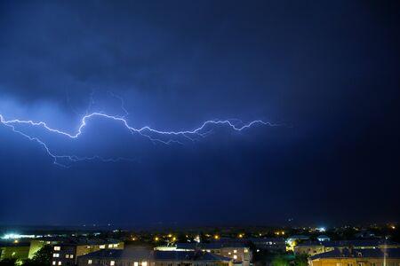 Lightning on a dark blue sky over the city.