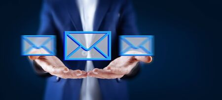 Businessman hand email icon on a virtual screen Stock Photo