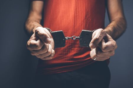 man hand handcuffs Stock Photo