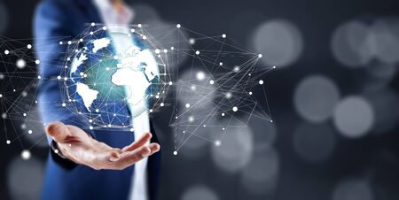 man hand globe network in screen Stock Photo