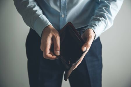 man hand  empty wallet on dark background