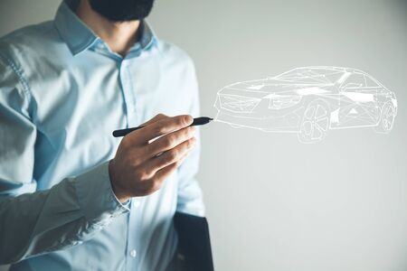 man drawing car in screen