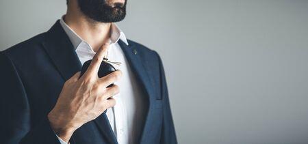 man hand perfume on gray background