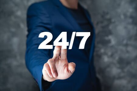 business man hand 24/7 support text in screen Stock Photo