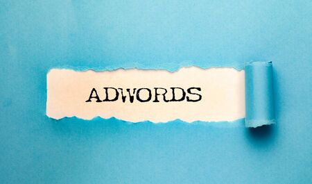 AdWords  word on torn paper Stock Photo