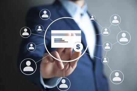man touching credit card in screen on dark background Stockfoto