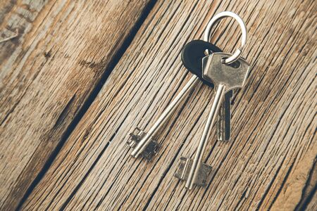 different keys on the wooden desk background