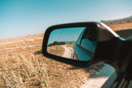 the car window with the road background Imagens