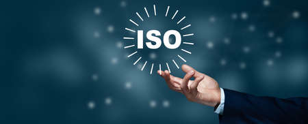 man hand iso text in screen on bokeh background