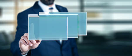 man touching files in screen in abstract background Banque d'images