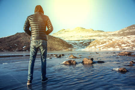 man on the ice in mountain at the sunset Stock Photo